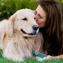 Perro y persona - Compromiso Bayer